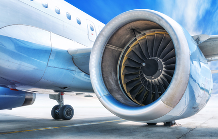 Photo for Jet engine against a blue sky - Royalty Free Image