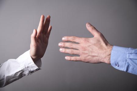 Foto de Female hand refusing male hand to shake. - Imagen libre de derechos