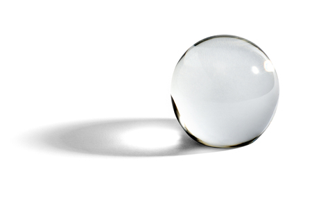 Photo pour Glass ball or orb for fortunetelling, soothsaying and predicting the future with a shadow on a white background with copyspace - image libre de droit
