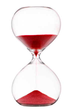 Foto de Red sand running through an hourglass with clear glass bulbs measuring passing time counting down to a deadline isolated on white - Imagen libre de derechos