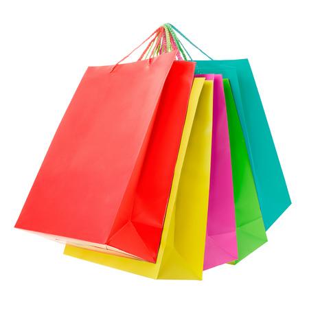 Foto de Colorful paper shopping bags on white, clipping path - Imagen libre de derechos