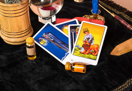 Photo for Laid out Tarot cards with magical decorations on the table - Royalty Free Image