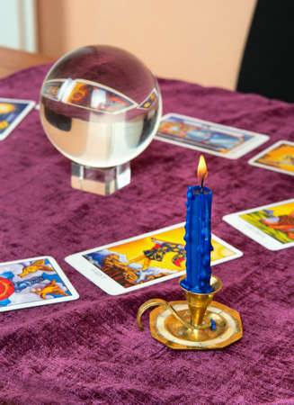 Foto de Laid out cards of the Tarot with the crystal ball and candle - Imagen libre de derechos