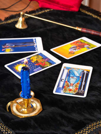 Foto de Laid out Tarot cards with a candle on the table - Imagen libre de derechos