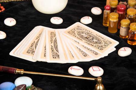 Foto de Tarot cards with runes and magical attributes on the table - Imagen libre de derechos