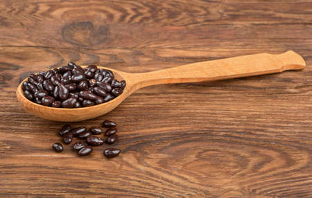 Photo for Sunflower seeds in the chocolate spoon on the table - Royalty Free Image
