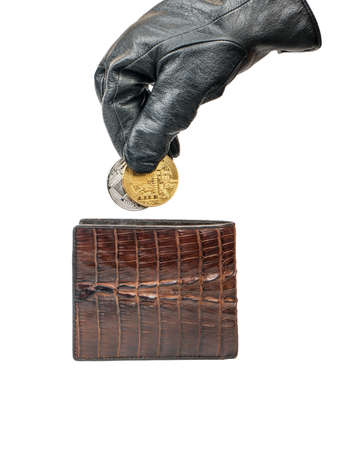 Photo pour Thief in gloves pulls out a silver and gold coin bitcoin of their wallet on white background - image libre de droit