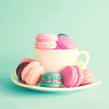 Photo for Vintage tea cup with macaroons - Royalty Free Image