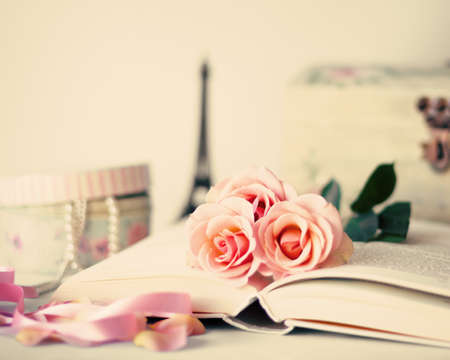 Photo for Roses over a vintage book - Royalty Free Image