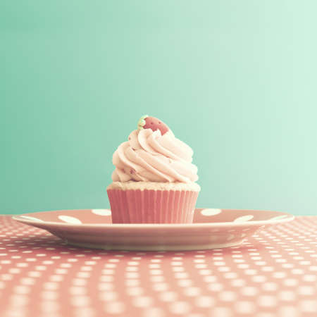 Photo for Strawberry cupcake over polka dots - Royalty Free Image