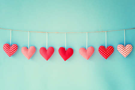 Photo pour Cotton hearts hanging from a clothes line - image libre de droit