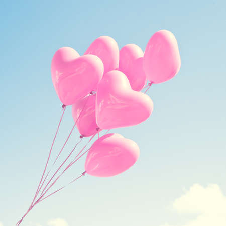Photo pour Pink heartshaped balloons - image libre de droit