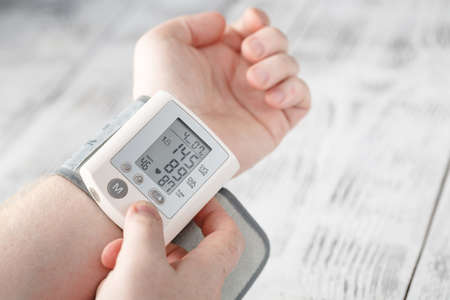 Foto per Man himself measured his own blood pressure on a wrist - Immagine Royalty Free