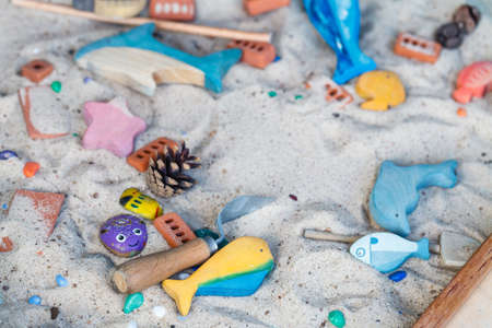 Foto de sand therapy. the child playing with toy the sand. the psychologist works - Imagen libre de derechos