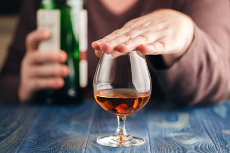 Foto de problem of alcoholism, man stop drinking more - Imagen libre de derechos