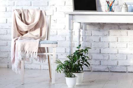 Foto de White interior with chair, rug and small table - Imagen libre de derechos
