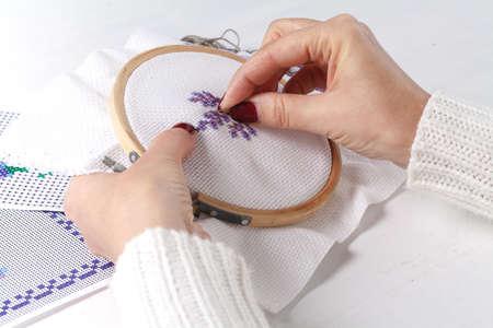 Foto de The process of working on a piece of embroidery, close-up - Imagen libre de derechos