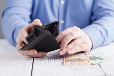 Foto de people, business, finances and money concept - close up of businessman hands holding open wallet with euro cash - Imagen libre de derechos