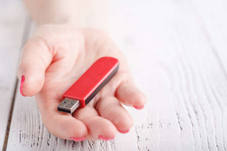 Photo for Close up view of usb flash pendrive in female hand - Royalty Free Image
