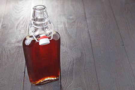 Foto de Homemade alcohol cordial drink in bottle on table - Imagen libre de derechos