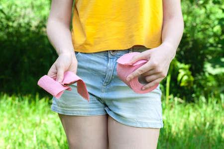 Foto de Female holding paper roll. Medical problems, incontinence, health care concept - Imagen libre de derechos