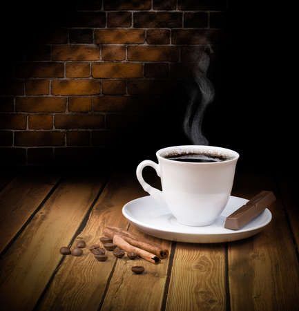 Black hot coffee cup with chocolate and cinnamon
