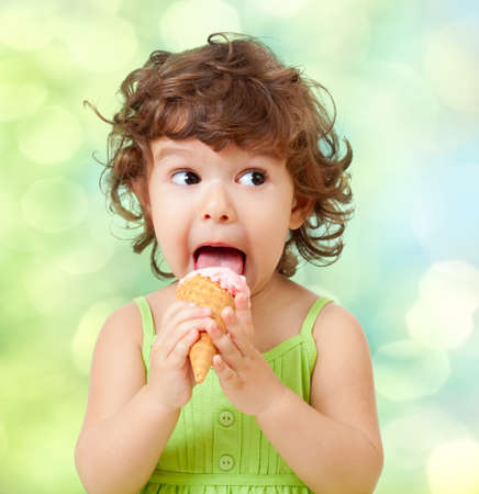 little curly girl with ice cream on colorful background