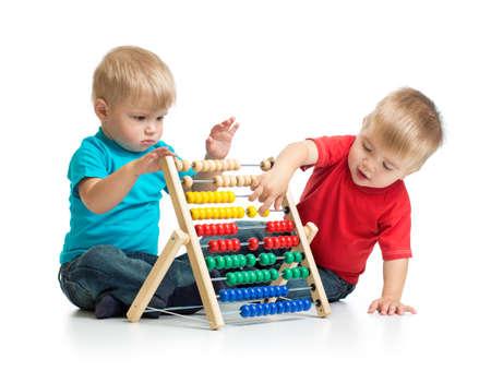 Foto de Kids playing colorful abacus or counter together - Imagen libre de derechos