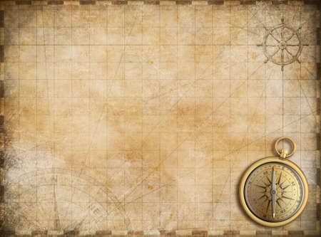 Foto de old map with brass compass as exploration and adventure background - Imagen libre de derechos