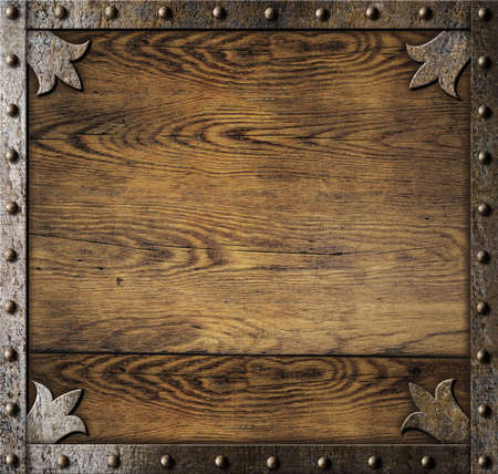 Photo for medieval metal frame over old wooden background - Royalty Free Image