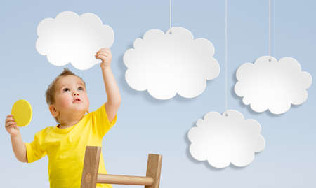 Photo pour Kid with ladder attaching clouds to sky - image libre de droit