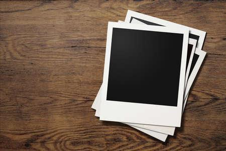 Photo pour polaroid photo frames on old wooden background - image libre de droit