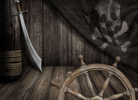 Foto de Pirates ship steering wheel with old jolly roger flag and saber - Imagen libre de derechos