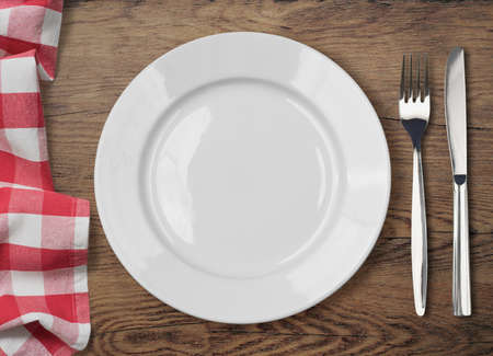 Foto per dinner table with dinning plate, fork and knife top view - Immagine Royalty Free