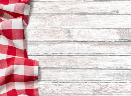 Photo pour kitchen table background with red picnic cloth - image libre de droit