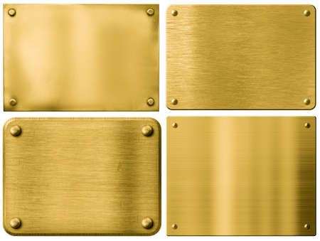 Foto de gold metal plates or sign boards set with rivets isolated on white - Imagen libre de derechos