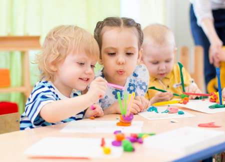 Foto de happy kids modeling or playing in kindergarten with interest - Imagen libre de derechos