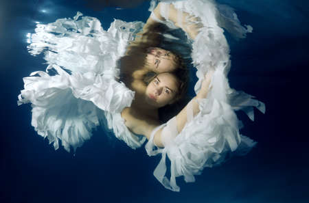 Photo for Young beautiful woman in the image of an angel underwater - Royalty Free Image