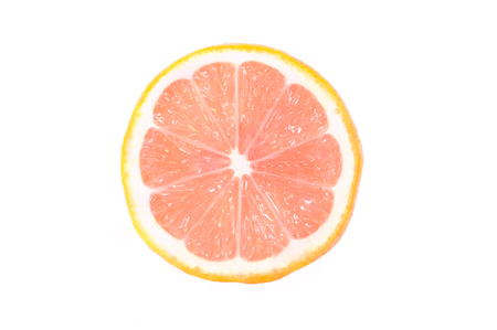 Photo pour One half of a ripe lemon with a pink flesh is isolated on a white background. - image libre de droit