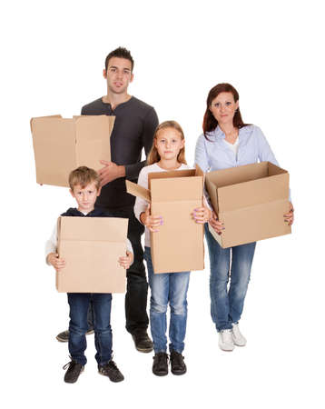 Photo for Happy young family carrying cardboard boxes  Isolated on white - Royalty Free Image