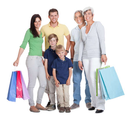 Happy generations family with shopping bags. Isolated on white