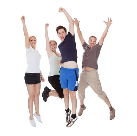 Happy excited family jumping. Isolated on white