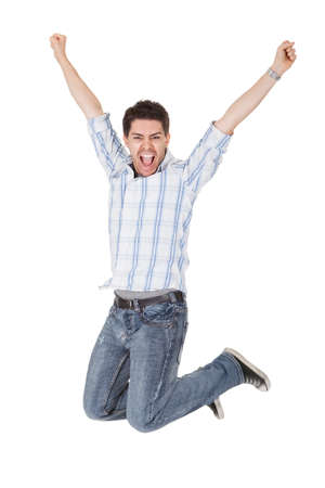 Photo for Casual handsome young man in jeans shouting for joy raising his hands above his head - Royalty Free Image