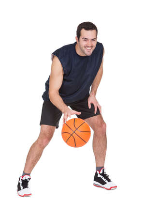 Professional basketball player with ball. Isolated on white