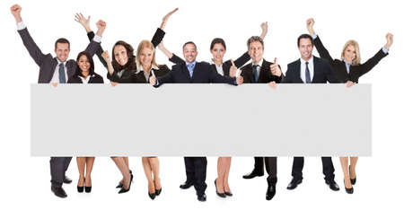 Photo for Group of excited business people presenting empty banner. Isolated on white - Royalty Free Image