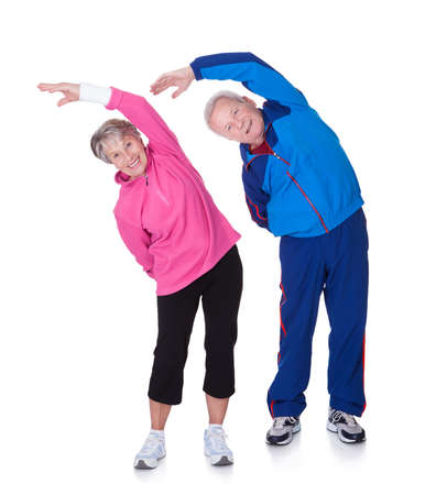Foto per Portrait Of A Senior Couple Exercising On White Background - Immagine Royalty Free