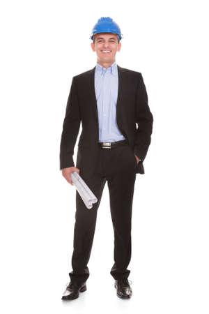 Foto de Happy Male Architect Standing Over White Background - Imagen libre de derechos