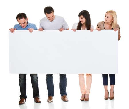 Photo pour Group Of Friends Holding Placard On White Background - image libre de droit