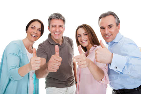 Photo for Group Of Happy People Showing Thumb Up Sign Over White Background - Royalty Free Image