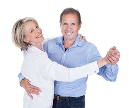 Photo pour Happy Mature Couple Dancing Isolated Over White Background - image libre de droit